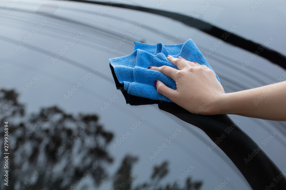 Fototapety, obrazy: hand cleaning car using microfiber cloth