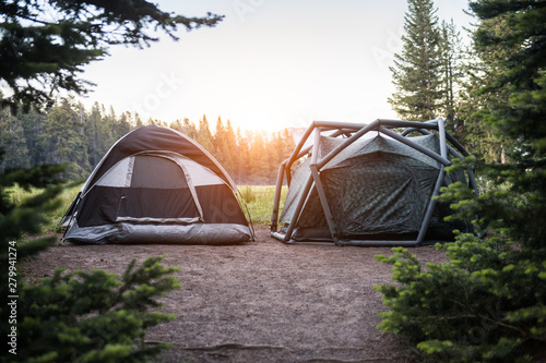 Foto auf Leinwand Grau Two modern tents on campsite in Yellowstone National park at sunset time