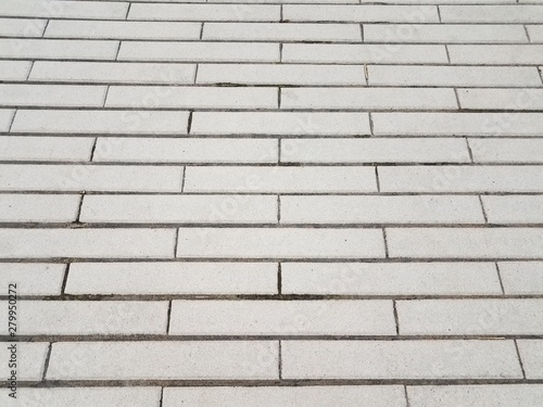 grey cement rectangle tiles on ground or floor