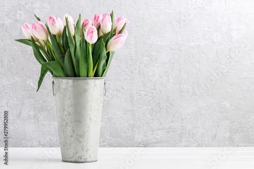 Fototapeta Pink tulips in silver bucket. obraz
