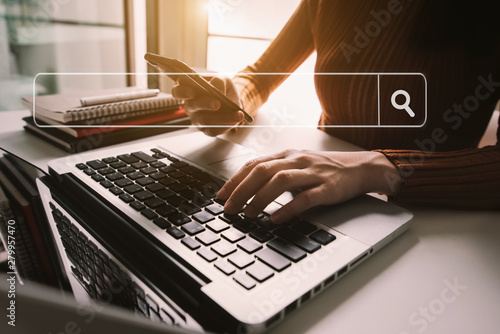 Searching Browsing Internet Data Information with blank search bar.businessman working with smart phone, tablet and laptop computer on desk in office. Networking Concept