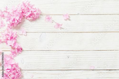 Tuinposter Hydrangea pink hydrangea on white wooden background