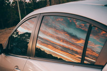 Sunrise And Car On The Road