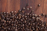 Coffee beans on dark wooden background