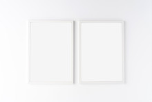 Two White Photo Frames With Co...