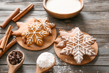 Composition With Tasty Christmas Cookies And Milk On Wooden Table