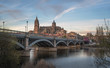 Salamanca Skyline view with Cathedral and Enrique Estevan Bridge from Tormes River at sunset - Salamanca, Castile and Leon, Spain