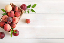 Ripe Peaches In A Box On Woode...