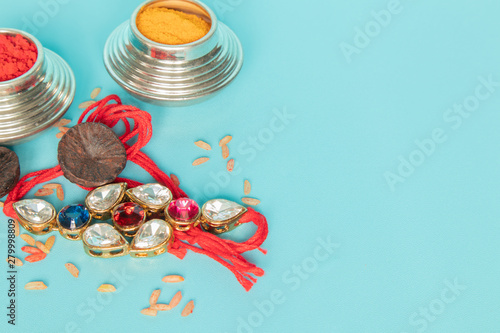 Raksha bandhan raakhi or rakhi with Kumkum,areca on blue background Canvas Print