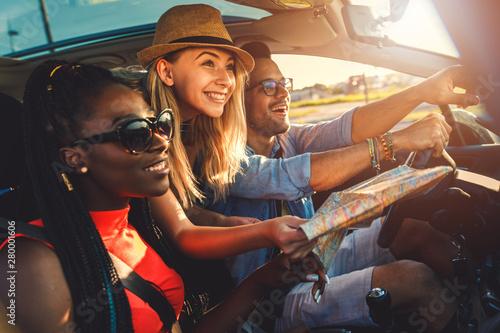Obraz Three best friends enjoying traveling at vacation in the car. - fototapety do salonu