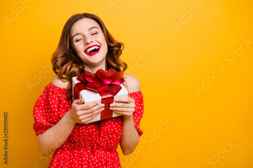 Pretty foxy lady got first big giftbox wear red dress isolated yellow background Canvas Print