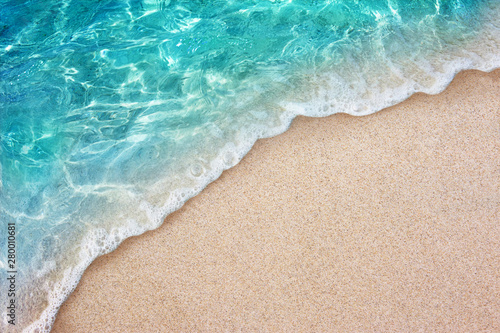 Soft blue ocean wave or clear sea on clean sandy beach summer concept