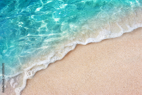 Obraz Soft blue ocean wave or clear sea on clean sandy beach summer concept - fototapety do salonu