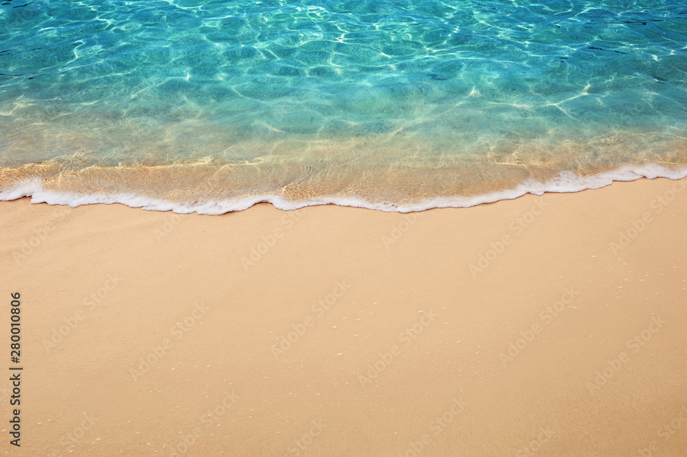 Fototapeta Soft blue ocean wave or clear sea on clean sandy beach summer concept