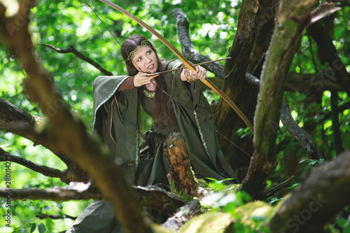Fotografija Elf archer with a bow in the forest