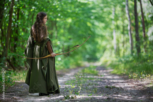 Elf archer from behind in the woods Canvas Print