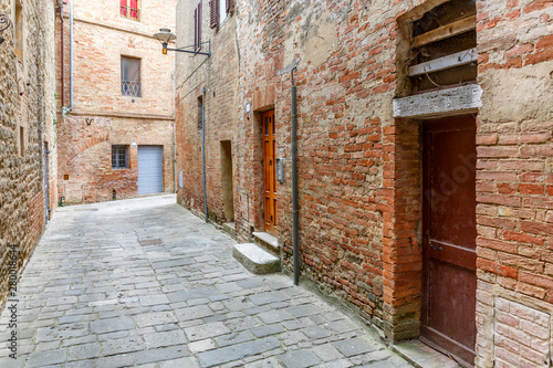 Photo sur Aluminium Ruelle etroite Doors in an old alley with paving stones