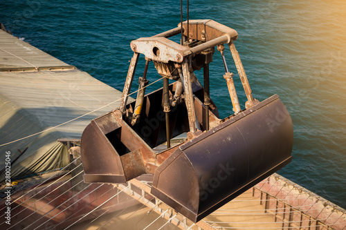 Loading wheat on cargo ship with crane and bucket Tablou Canvas