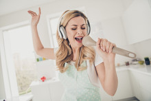 Portrait Of Her She Nice Attractive Lovely Cheerful Cheery Glad Positive Wavy-haired Lady Maid Having Fun Singing New Cool Popular Hit Sauce Spoon In Light White Interior Kitchen