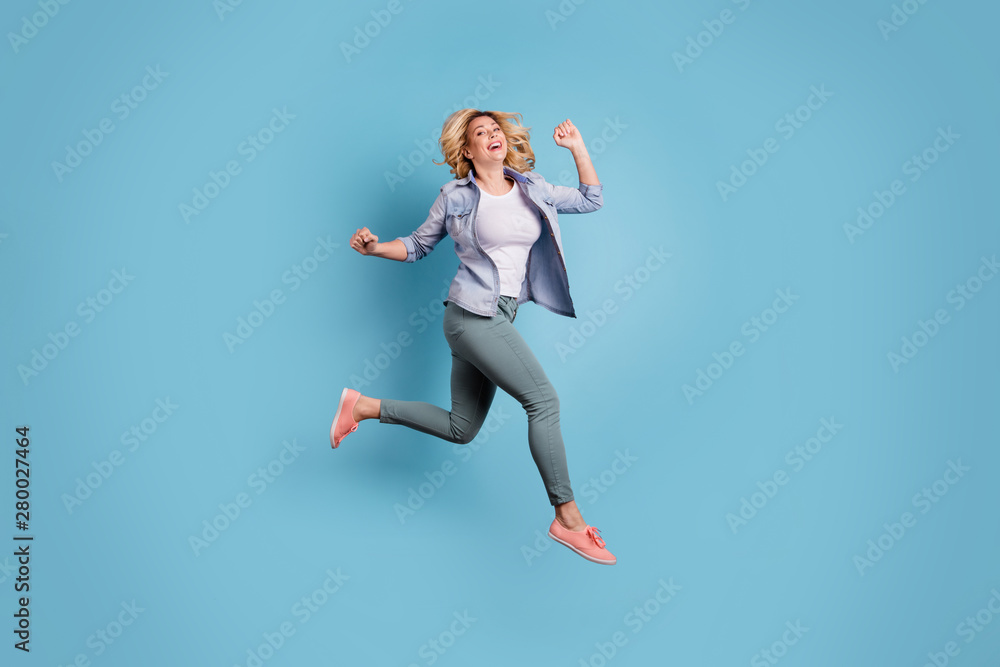Fototapety, obrazy: Full length photo of lovely charming person raising arms laughing wearing pants trousers isolated over blue background