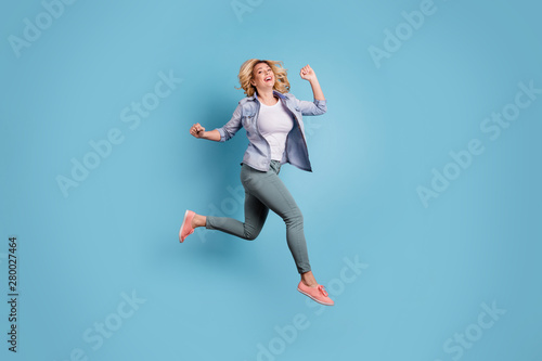 Fototapeta  Full length photo of lovely charming person raising arms laughing wearing pants