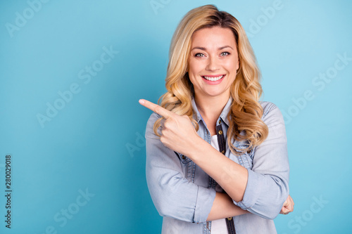 Portrait of cute confident person pointing at copy space showing adverts isolate Wallpaper Mural