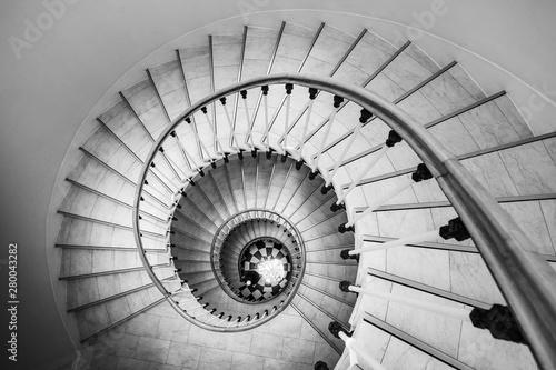 Fotografija Beautiful circular staircase in old house, snail geometry