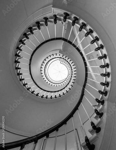 Canvas Beautiful circular staircase in old house, snail geometry