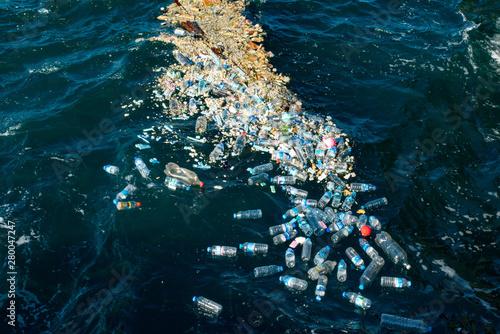 Fototapeta Plastic water bottles pollute ocean obraz