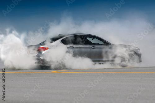 Leinwand Poster Modern car burnout. Auto make tire smoke and drift
