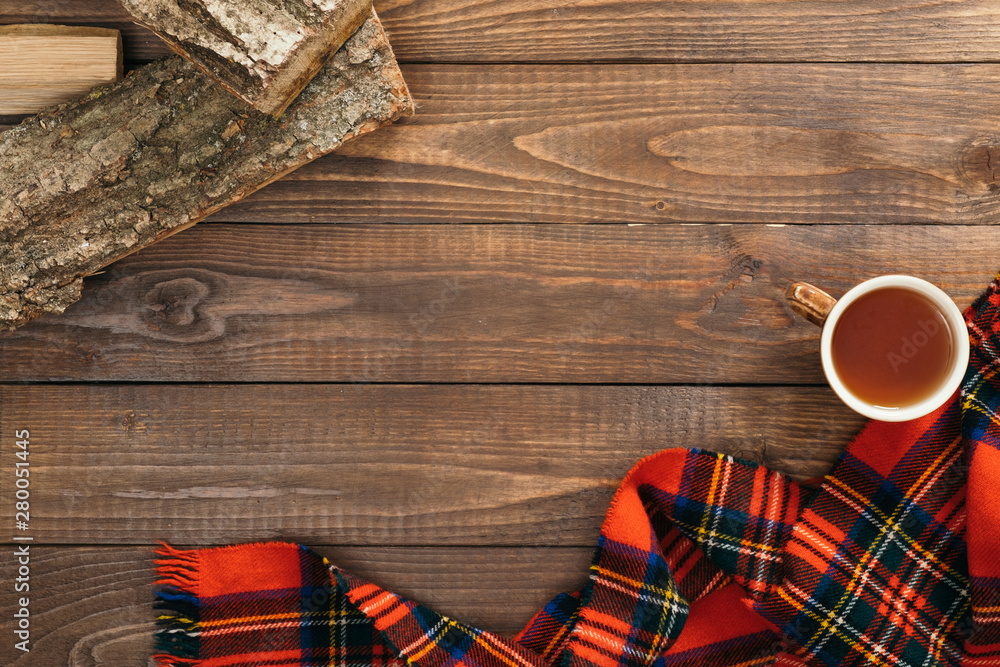Fototapety, obrazy: Scandinavian hygge style autumn flatlay composition. Frame of fashion feminine red scarf, cup of tea, firewood on wooden background. Flat lay, top view, copy space. Cozy home office desk table concept