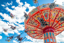 Tampere, Finland - 24 June 2019: Ride Swing Carousel In Motion In Amusement Park Sarkanniemi On Blue Sky Background