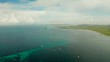 Seascape: Blue sky with clouds over the sea with islands, aerial view. Summer and travel vacation concept. Siargao,Philippines.