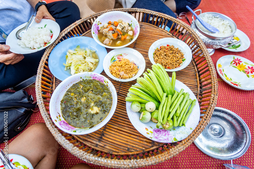 Thai Traditional Northern or Isan Food Dinner (Kantoke or Khantoke) for Serve on Thai Mat Canvas Print