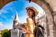 Leinwandbild Motiv A young woman enjoying her trip to the Castle of Budapest