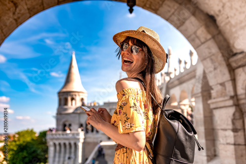 obraz dibond A young woman enjoying her trip to the Castle of Budapest