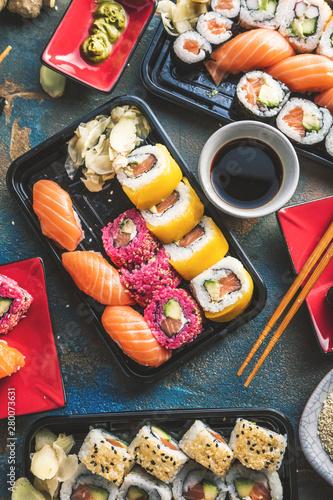 Poster Montagne Sushi Set sashimi and sushi rolls served on stone slate