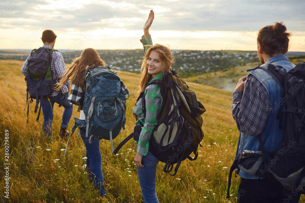 Fototapety, obrazy: Group of friends trekking with backpacks walking in the forest .