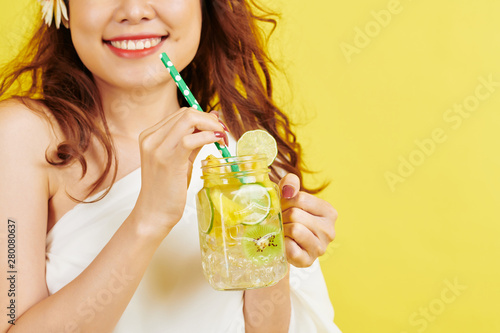 Wallpaper Mural Close-up of young woman smiling while drinking non-alcoholic refreshing drink fr