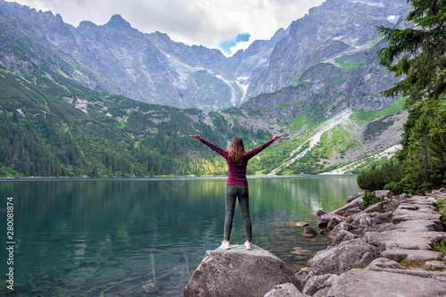 Young tourist girl on Lake Morskie Oko (Sea Eye), Zakopane, Poland, High Tatras