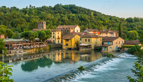 Spoed Fotobehang Zwaan The beautiful village of Borghetto near Valeggio sul Mincio. Province of Verona, Veneto, Italy