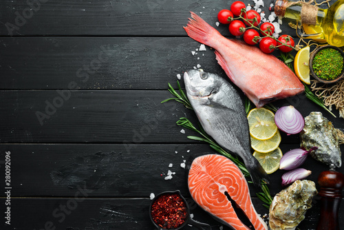 Seafood on a black wooden background. Banner Top view. Free space for your text. - 280092096