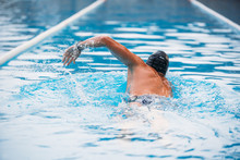 Athletic Young Man Swimming Th...