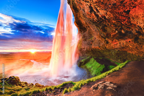 Seljalandsfoss waterfall in Iceland, Europe. Picturesque landscape photography in golden hour, day to night time, sun flare opposite of incredible Icelandic waterfall Seljalandsfoss - iconic landmark. - 280098217