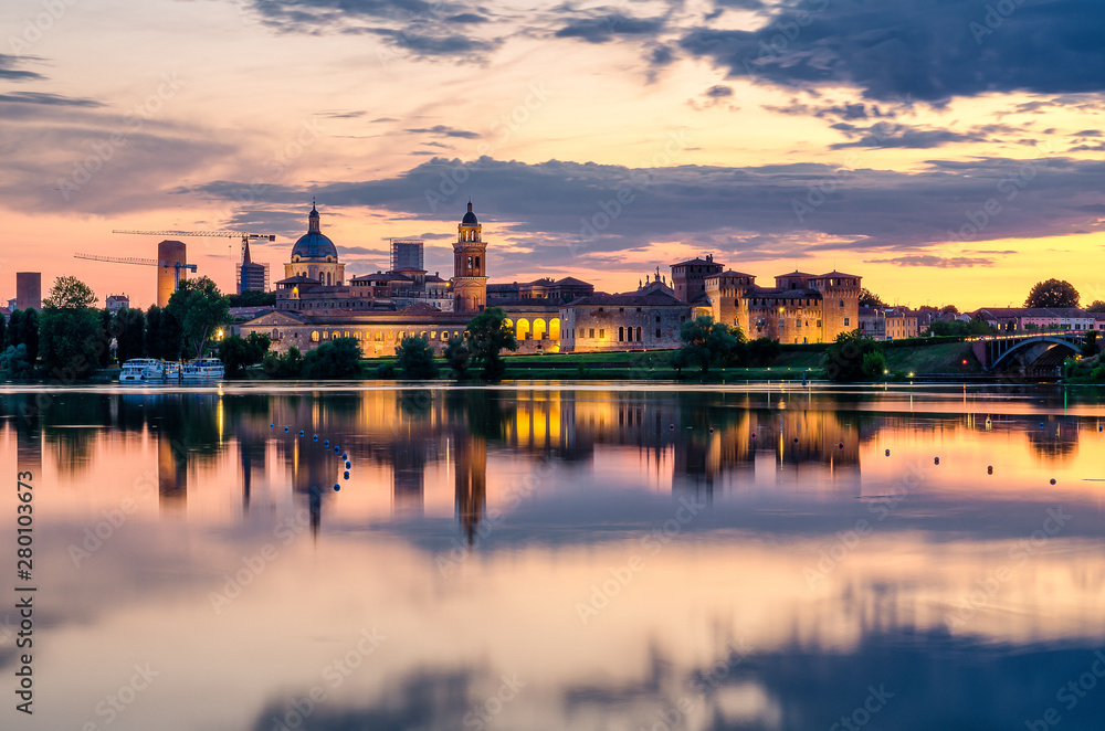 Fototapety, obrazy: View of the city of Mantua at sunset reflected on the Middle Lake on the Mincio River