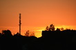 canvas print picture - silhouette of factory at sunset