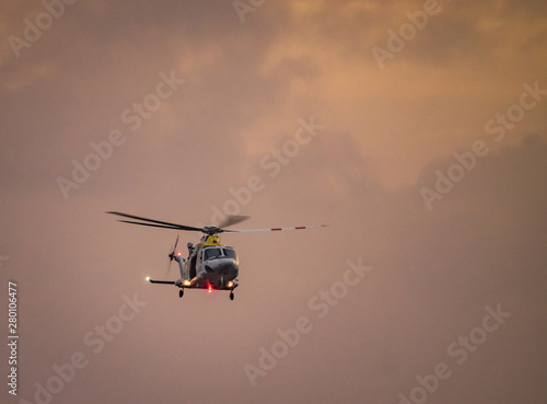 Staande foto Helicopter in the sunset over the Caribbean island of Curacao