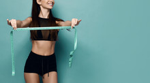Positive Weight Loss Diet Results. Happy Slim Woman In Sport Wear With Measuring Tape