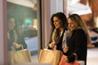 Happy young women with shopping