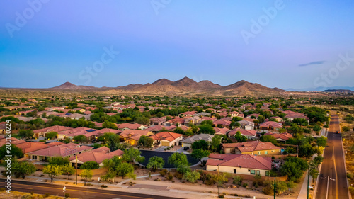 Aerial view of a desert community in Arizona during the golden hour at sunset Wallpaper Mural